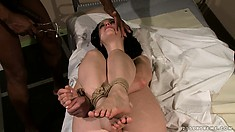 Obedient slave swallows her master's cum through an open mouth gag