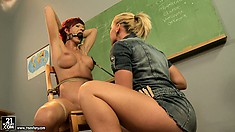 Redhead gets strung up and gagged by Kathia and gets whipped
