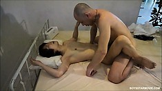 Pale asian twink with a tiny cock sucks off his lover in bed