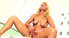 Sensuous blonde cougar Merilyn displays her lovely body in the bathtub