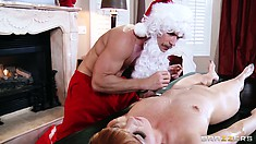 She's been so good that Santa uses a new toy on her oily pussy