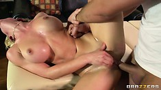 Oily blonde gets her clit stimulated and pussy fucked sideways