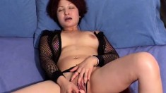 Buxom Loanne stuffs a dildo inside her peach and sighs with pleasure