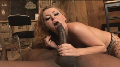 Horny Sophie Dee surrenders her fiery anal hole to a long black stick