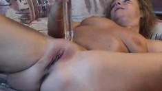 Big breasted mature Lia finds herself alone and fucks a glass dildo