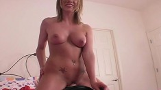 Samantha rides the sybian and fingers her snatch to reach her climax