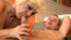 Luscious blonde mommy has a young man's dick taking her cunt to climax