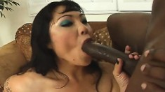 Sexy slim Oriental cutie feeds her hungry anal hole a big black stick