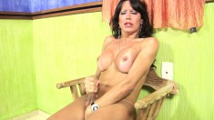 Sensual tranny with big hooters jerks off her long pole for the camera