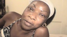 Dark Skinned Nympho Susan Sends Her Lips Pleasing A Long White Stick