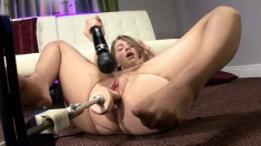 Alaina Fox toys her clit while a mechanical dildo fucks her honey hole