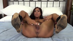 Bodacious brunette beauty Stacy Jay sensually masturbates on the bed