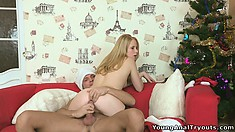 Barely legal blonde cutie takes a ride on Santa's hard member