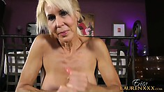 Hot blonde cougar with a sexy ass strokes a big cock until it explodes with pleasure