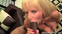 Busty blonde cougar Karen Fisher finds herself a cock to chew on
