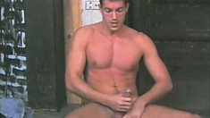 Buff stud Tony Cummings spreads his ass cheeks for the camera and strokes his huge dick