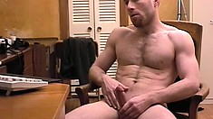 Ripped stud with a hairy chest jerks off during a slow day at work
