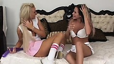 Cheerleader lesbians play with toys then they cum with the double dong