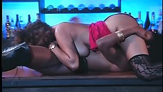 Champagne Pendavis and Kira B. pleasuring each other on top of the bar counter