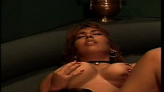 Tasty ebony babe is massing her own tits and then gets seduced by another women