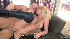 Blonde in high boots finishes her man off with a rusty trombone