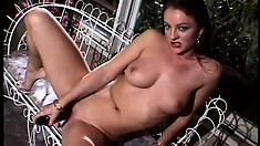 Ravishing babe with fabulous tits and ass uses a dildo to please herself