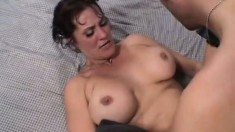 Busty brunette mom in black boots Candy Vegas fucks a young stud's cock