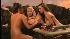 Wild blonde joins two sultry brunettes for an intense lesbian threesome