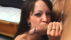 Buxom brunette in black stockings happily takes a long dick up her ass