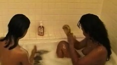 Two sultry Oriental babes reveal their naughty side in the bathtub