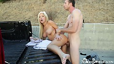 Blonde gets banged on the side of the road in the back of a truck