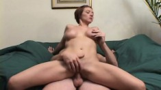 Busty redhead eats him meat and gets laid out and banged on the couch