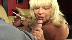 Kinky blonde granny works her sexy lips and her gifted hands on a cock