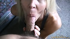 Horny blonde lady with a sexy ass and lovely tits lies on the bed fingering her cunt