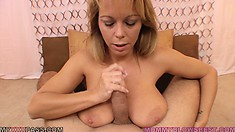 The wild blonde gives him a great blowjob and finishes him off with her huge boobs