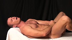 Stud Thomas Bjorn works his amazing meat and dumps his load on his abs