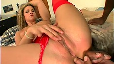 Stacked blonde in sexy red lingerie seduces a black stud to fuck her hungry holes