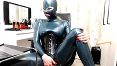 Black Angelica toying in latex