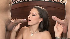 Sexy young brunette has two cocks to lick and swallow in this double blowjob