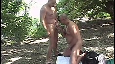 Horny gay stud has a younger guy blowing his big cock and fucking his tight ass