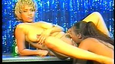 Two interracial lesbians fuck at a strip club using a double sided dildo