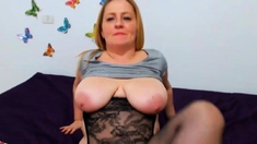 Webcam Huge titted blonde bounces and plays with dildo