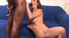 Busty milf gets on top of a black stud and wildly fucks his huge stick