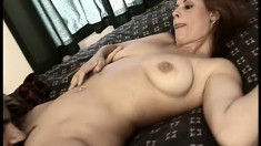 Young redhead with big tits gets drilled in both holes by two studs
