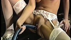 Busty babes Candy and Mila drill each other's holes with a huge dildo