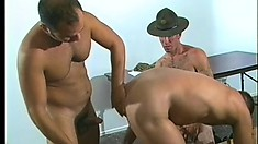 Three horny military guys suck and stroke each other's hard cocks