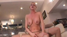 A blonde milf with a perfect rack feels a hard cock deep in her ass
