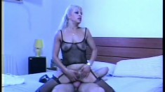 Steamy action with this blonde mom in fishnets riding his shifter